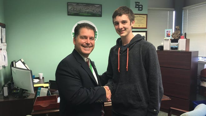 East Brunswick High School student-athlete Evan Dekhayser (right) with Principal Dr. Michael W. Vinella after Dekhayser was named Student of the Month in December 2016