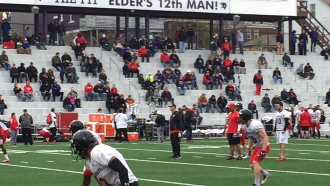 University of Cincinnati players got a taste of Queen City history Saturday with a scrimmage at the Elder High School 'Pit.'