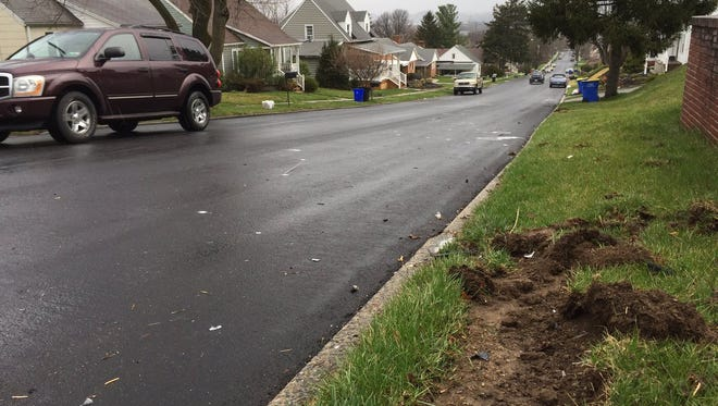 Chewed-up earth and fresh spray paint mark a truck's path after it was struck in Spring Garden Township on Monday night.