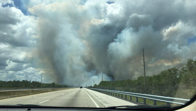 Brush fire just north of I-75 near mile marker 56 (Cowbell Fire) inching closer to the highway Tuesday afternoon. Some parts of median burning.
