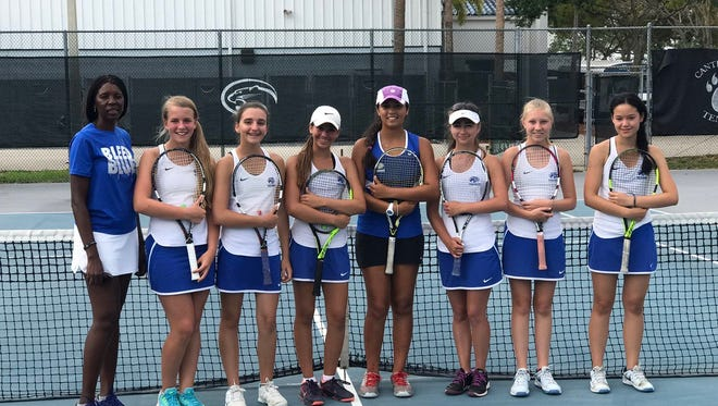 The Canterbury girls tennis team celebrates their first berth to a regional final after a 7-0 victory over Out-of-Door Academy on Tuesday.