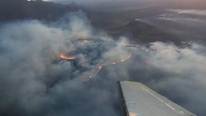 Strong, gusty winds and low humidity levels are expected to contribute to the spread of the Sawmill Fire, which is burning south of Tucson, covering over 15,000 acres, according to Arizona Department of Forestry and Fire Management officials.