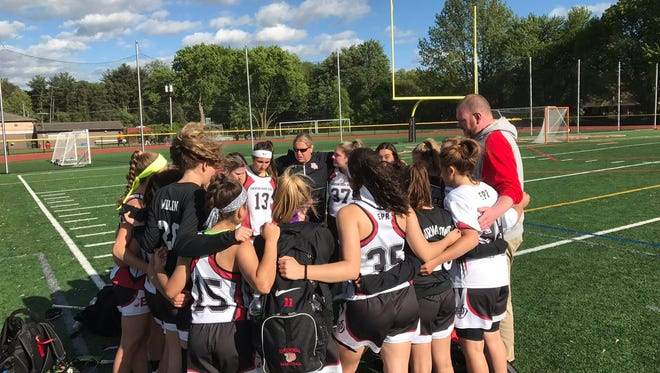 Emerson/Park Ridge's girls lacrosse team huddles up after its win over Saddle Brook on Monday, May 15, 2017.