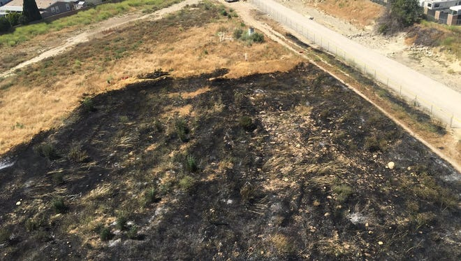 A grass fire burned 1.6 acres next to the Santa Clara riverbed in Santa Paula on Sunday.