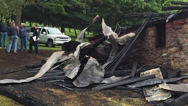 Police and the fire marshal are investigating the cause of a blaze that destroyed an East Manchester Township barn on Sunday.