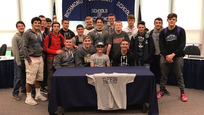 Richmond High School senior Roy Costello poses with his teammates after signing with Tiffin University