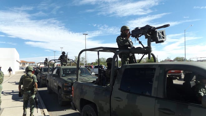 Mexican soldiers prepare to deploy as part of a rapid reaction force in March in Cuauhtémoc, Chihuahua.