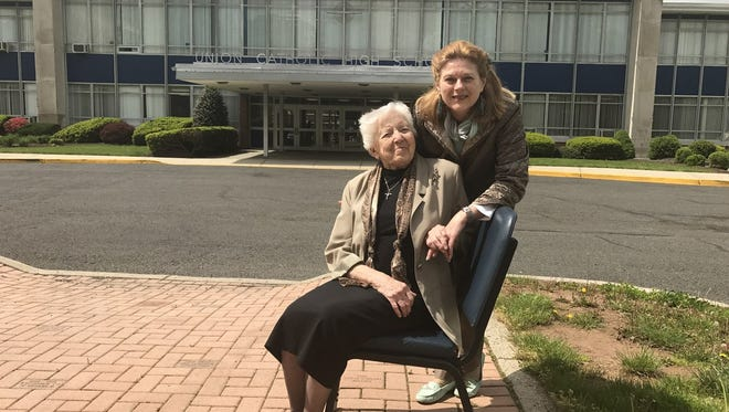 Jeanne Statile (right) and Sister Helen Francis at the entrance of the Our Lady of Grade Memorial Pathway in front of Union Catholic High School.