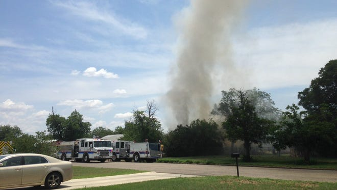 Emergency personnel are responding to a structure fire at the 400 block of E 21st Street on Thursday afternoon.