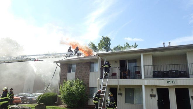 An IFD crew battles a fire at the Nora Pines Apartments in north Indianapolis.