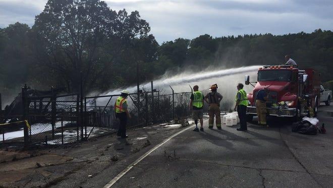 Pickens County fire crews use foam to help penetrate debris smoldering from the Cateechee Mill fire.