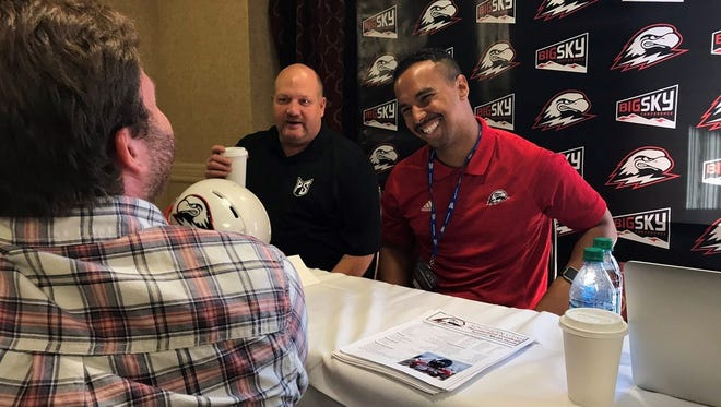 SUU head coach Demario Warren and Portland State head coach Bruce Barnum share a laugh at the Big Sky Kickoff Tuesday.