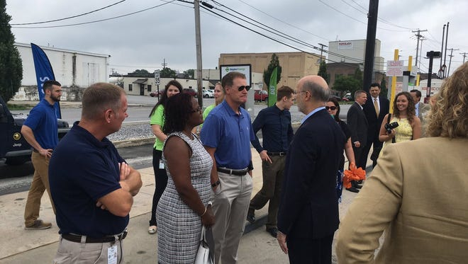 Gov. Tom Wolf, right, speaks with Mayor Kim Bracey and public works director Jim Gross at a ribbon-cutting ceremony for Shipley Energy's CNG fueling station in Spring Garden Township on July 28. Photo by David Weissman