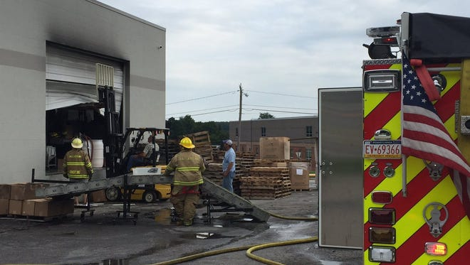 Fire crews put out a fire at Custom Molds and Plastics in Red Lion Friday, Aug. 11, 2017.