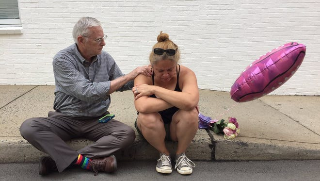 Bob Kiefer doesn't know Mai Shurtleff but he felt compelled to console her as she wept on the street where a woman died in Charolettesville.