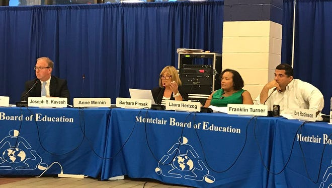 Montclair interim schools superintendent Barbara Pinsak,second from left, speaks during Aug. 21 Montclair BOE meeting about repairs to schools in the summer and new hires.