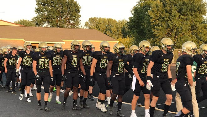 West busted out a black-on-black look for Friday's home opener versus Muscatine, topping off the uniform combo with a gold helmet and green numerals outlined in gold.