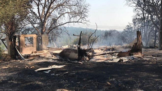 A fire in Oak Run burned more than 20 acres , ncluding a home early Friday afternoon.