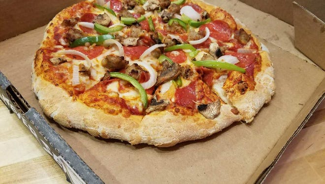 The Toppers Classic Pizza pepperoni, sausage, mushrooms and green peppers.