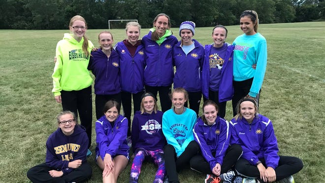 New Berlin Eisenhower's girls cross country team celebrates its first invitational win since at least 2008.
