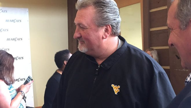 Former University of Cincinnati coach Bob Huggins, now head coach at West Virginia, speaks with fans at the Bearcats' 25th anniversary Final Four reunion in August.
