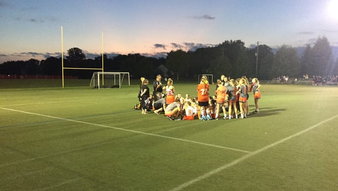 The Palmyra field hockey team meets at halftime of Monday night's 1-0 loss to Lower Dauphin at In The Net.