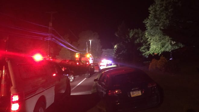 Police and fire officials at the scene of a fatal crash involving a pedestrian in the 4800 block of South Salem Church Road in Dover Township Thursday night.