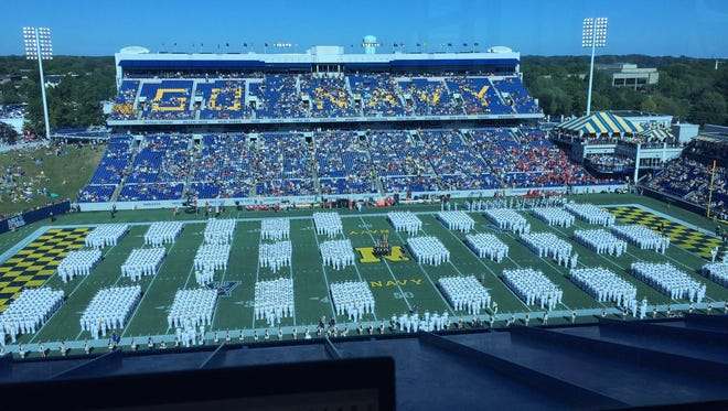 The March-On Brigade of Midshipmen is an Annapolis football tradition, shown here just minutes before Saturday's UC-Navy kickoff.