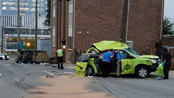Cab driver killed in downtown crash.