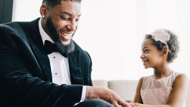 Devon Still and his daughter, Leah, at the wedding of Devon and Asha Joyce, who were last year's The Knot Dream Wedding couple.