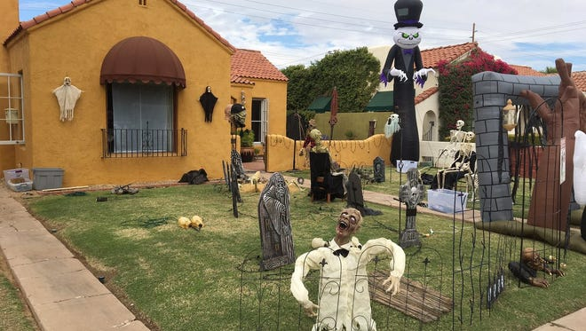 Residents in central Phoenix's F. Q. Story District decorate their homes to prepare for a large crowd of trick-or-treaters every year.