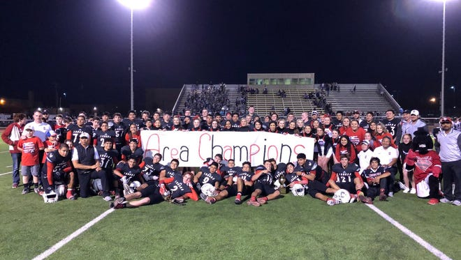 The Sonora High School football team poses after its 56-8 area round playoff win over Spearman on Friday in Abernathy.
