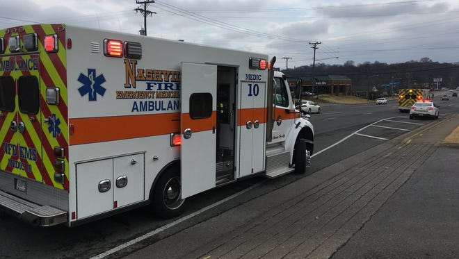 An ambulance arrives to transport students injured in a wreck involving two Metro Nashville school buses.