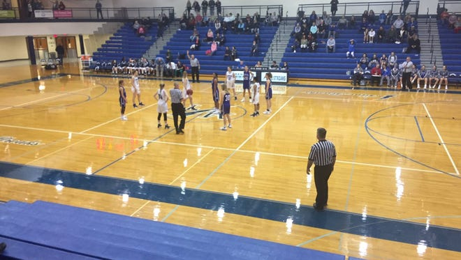 The Cedar Crest and Manheim Township girls basketball teams line up for the opening tip prior to Friday night's contest in Neffsville.