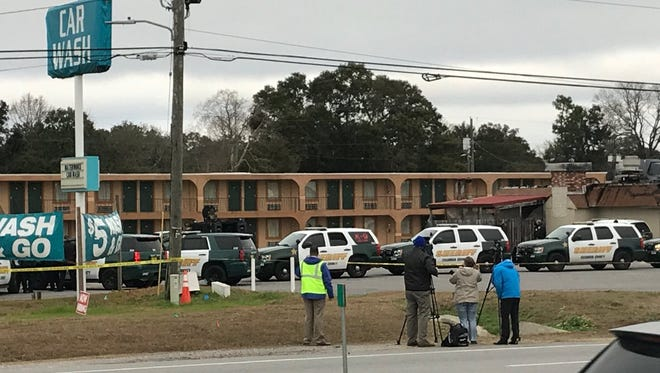 Escambia County Sheriff's Office deputies are responding to a man with active felony warrants has barricaded himself in a room at Budget Inn on 554 E. Nine Mile Road.