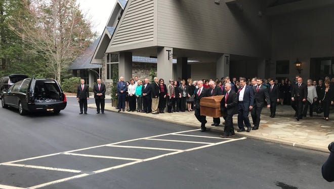 Body of the Rev. Billy Graham is transferred to hearse. Motorcade underway at about 11:05 a.m.