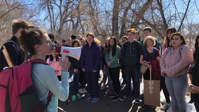 Students at Cache la Poudre Middle School gather for the start of a school walkout in response to gun violence in schools. Some teachers are taking notice of national activism, including teacher strikes, as a means of protesting poor funding.