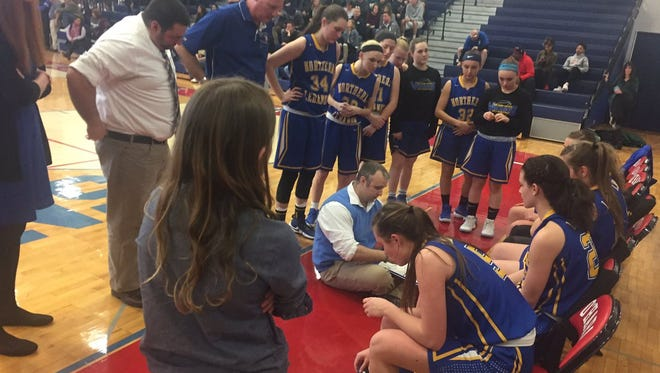 Northern Lebanon coach Ken Battistelli huddles with his team late in Saturday's 41-37 loss to Bonner/Prendegast in the opening round of the 4A state playoffs.