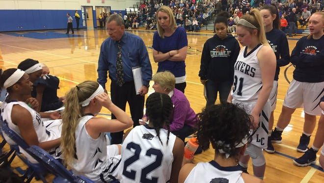 Lebanon Catholic coach Patti Hower (center) gives instructions to her team prior to the start of the fourth quarter of Saturday's 50-46 loss to Jenkintown in the state semifinals.