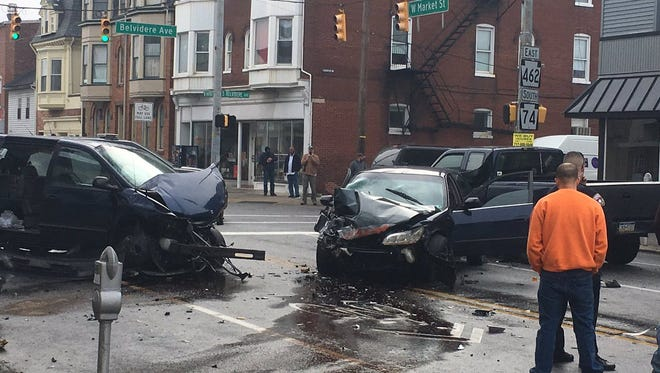 Emergency crews work at the scene of a multi-vehicle crash on West Market Street, between Carlisle and Belvidere avenues in York City Thursday, March 29, 2018. David Weissman photo