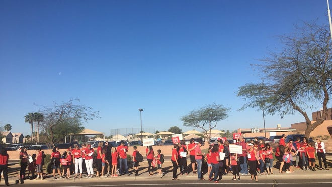 Teachers at Tarwater Elementary in Chandler stage a walk-in with parents and students in solidarity with #RedForEd on April 4, 2018.