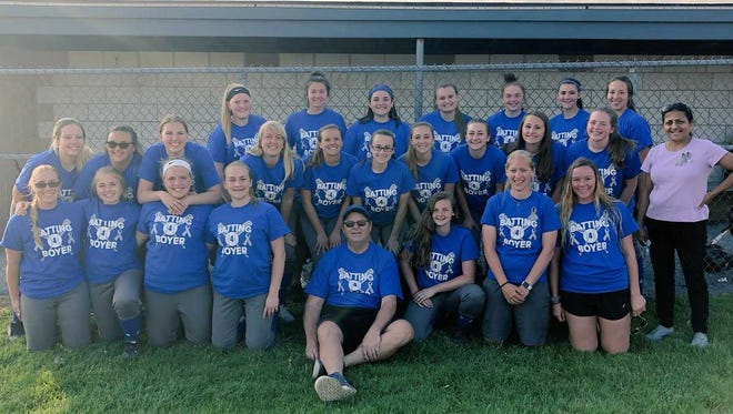 Assistant coach Craig Boyer, front row, center, was joined by Cedar Crest softball players and coaches and Kala Venkiteswaran Ph.D from Penn State Hershey for last season's Batting for Boyer game vs. Warwick that aided in the fight against Parkinson's Disease.