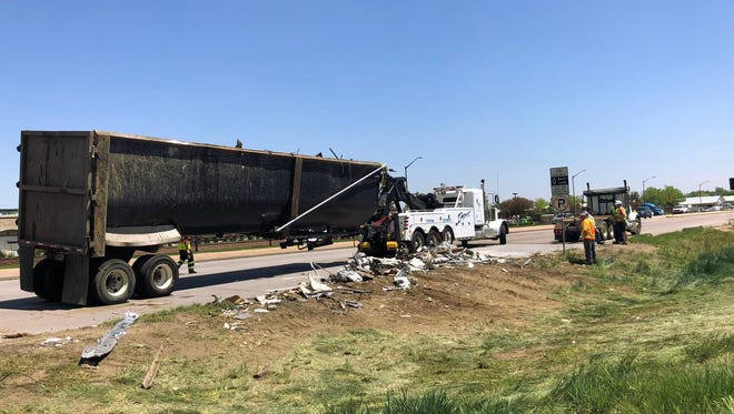 Debris litters the roadway near Mulberry Street and Lemay Avenue in Fort Collins on Thursday after a semi overturned.