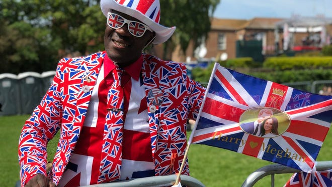 Joseph Afrene waits in Windsor on May 18, 2018, in anticipation of Saturday's royal wedding.