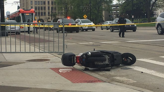 A scooter crash near the Detroit Institute of Arts left the rider critically injured and temporarily halted QLINE streetcars.