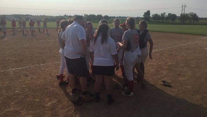 The Annville-Cleona softball team formed a celebratory huddle after Wednesday's 5-0 district quarterfinal win at Pequea Valley.