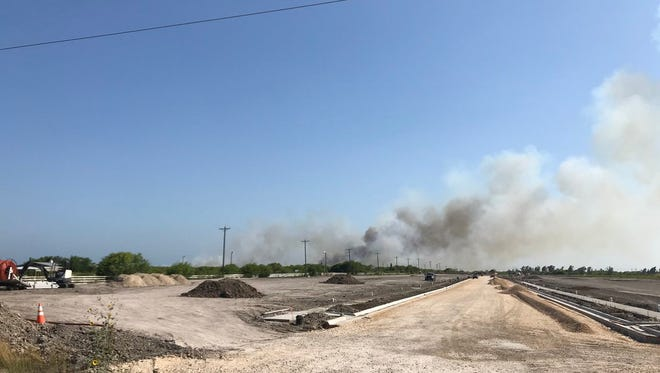 Firefighters battle a grass fire Thursday that spread from Corpus Christi into the King Ranch.