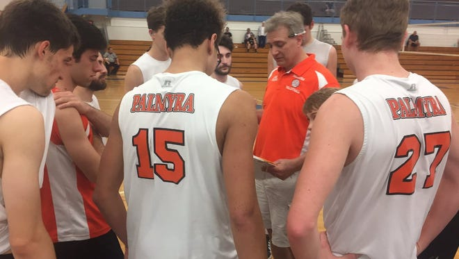 Palmyra boys volleyball coach Clark Sheaffer gives his team, including Nick Mosby (15) and son Tyler Sheaffer (27) prior to the third set of Saturday's 3-0 state quarterfinal win vs. Holy Redeemer at Minersville High School.
