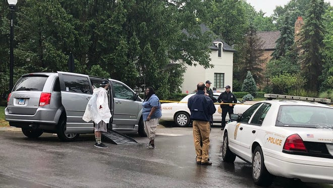 A wheelchair van and police wait for the removal of protesters at HHS Secretary Alex Azar's home on Sunday.