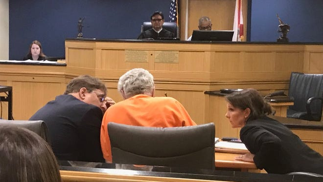 Defense lawyers chat with  James Morgan as his murder resentencing begins June 11, 2018.